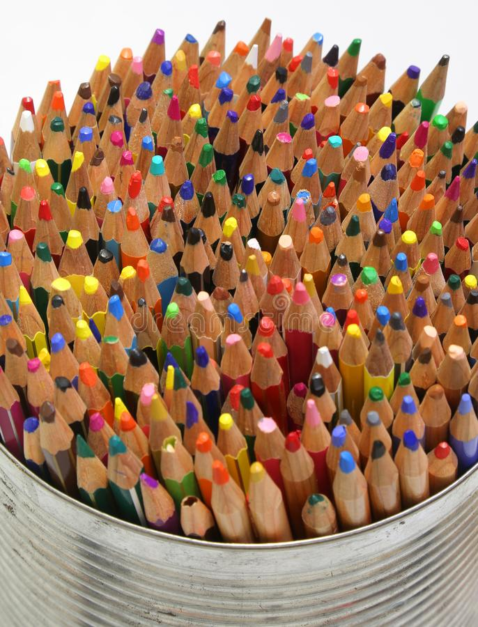 pencil and crayons in the metal jar royalty free stock image