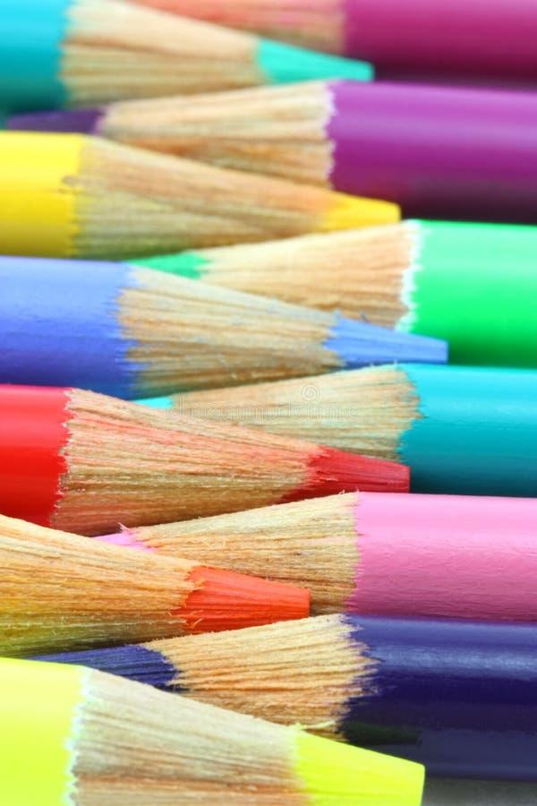 Pencil crayons, horizontal rainbow of colors stock photos