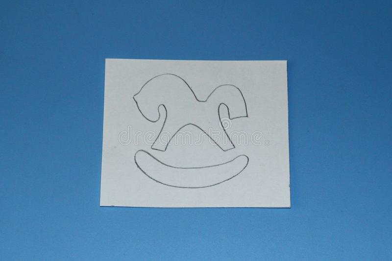 Pencil drawing rocking horse on a white sheet of paper.  royalty free stock images