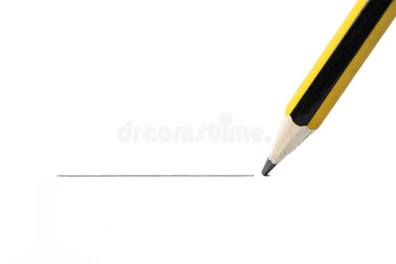 Pencil drawing a straight line, isolated on white background. Close up stock photos