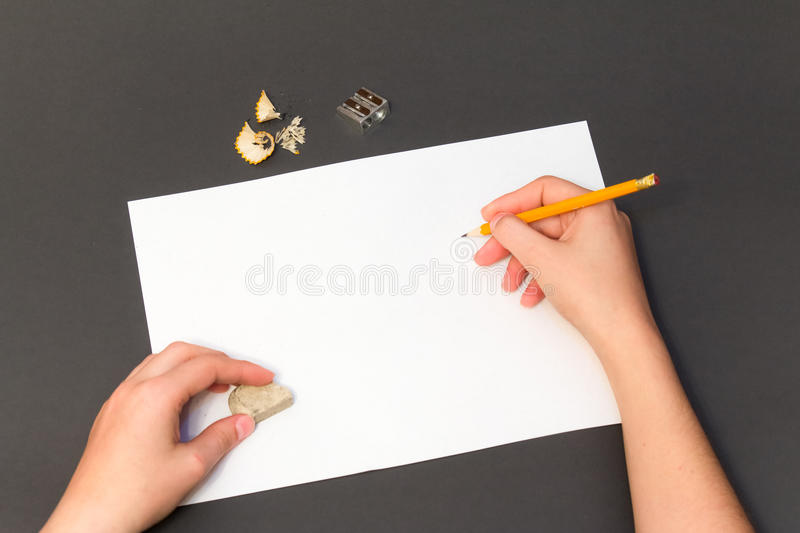 Pencil drawing on a white sheet stock photos