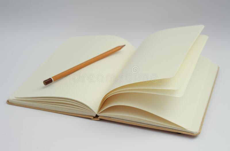 Pencil on empty book stock image