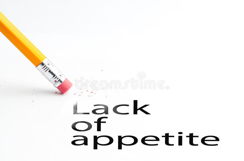 Pencil with eraser. Closeup of pencil eraser and black lack of appetite text. Lack of appetite. Pencil with eraser royalty free stock photo