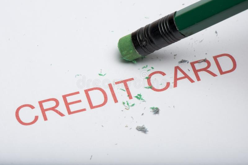 Pencil Erasing the Word `Credit Card` on Paper stock image