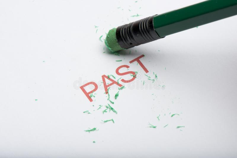 Pencil Erasing the Word `Past` on Paper royalty free stock images