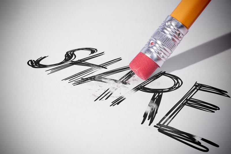 Pencil erasing the word Share. On paper stock images