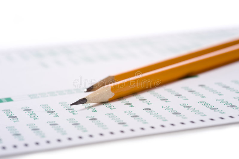 Pencil on Exam. A yellow pencil on a computer read examination or test royalty free stock photography