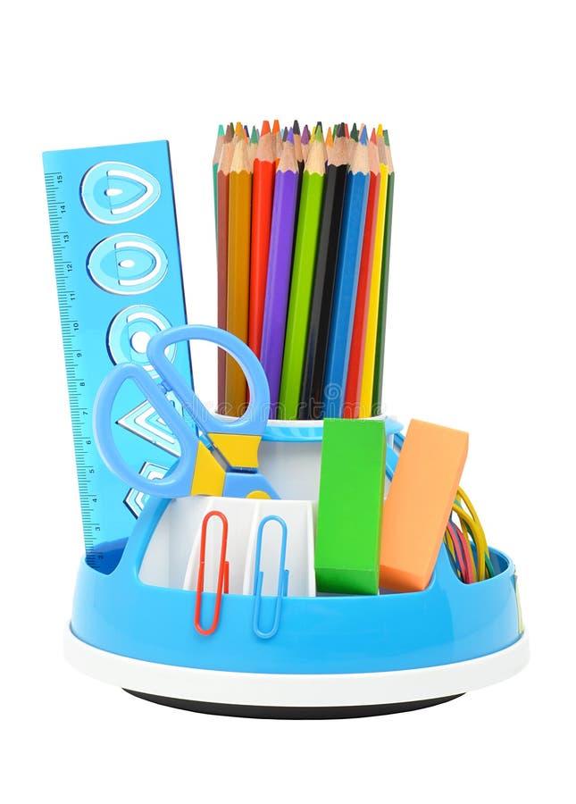 Pencil hållaren med regel, sax och radergummin arkivfoto