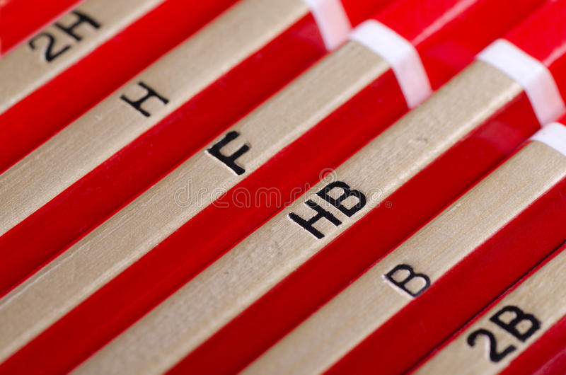Pencil hardness. Row of graphite pencils various hardness stock image