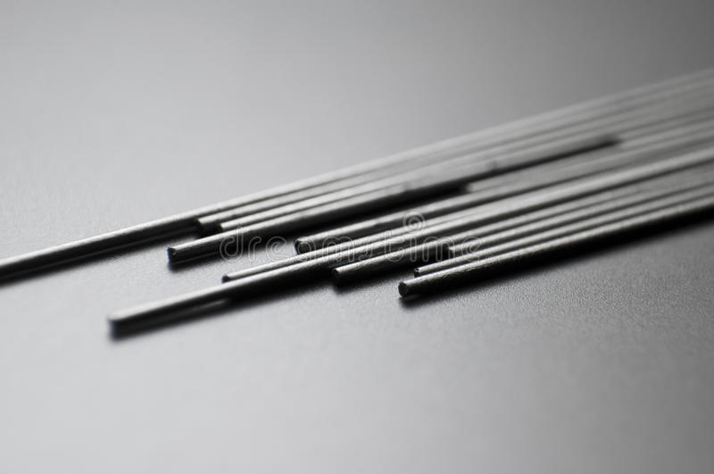Pencil leads. Graphite pencil leads on black surface stock photo