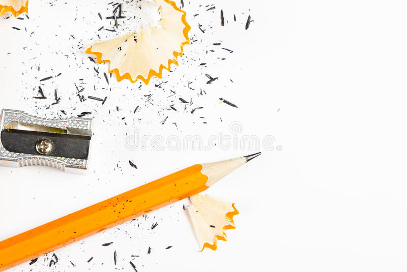 Pencil, metal sharpener and pencil shavings. Pencil, metal sharpener and pencil shavings on white background. Horizontal image stock photo