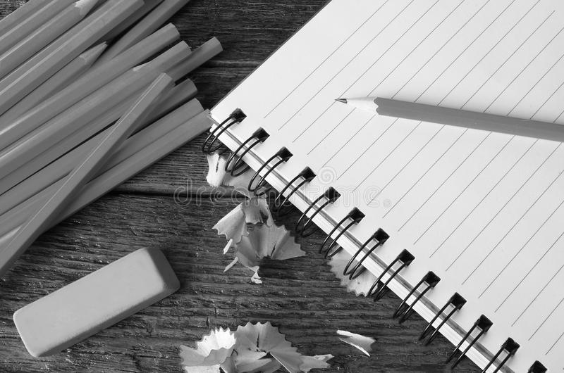 Pencil and Notebook Close Up. A top view image of several sharpened wooden pencils stock images