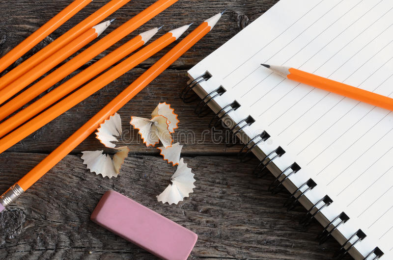 Pencil and Notebook Close Up. A top view image of several sharpened wooden pencils royalty free stock photos