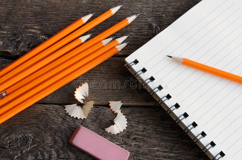Pencil and Notebook Close Up. A top view image of several sharpened wooden pencils royalty free stock image
