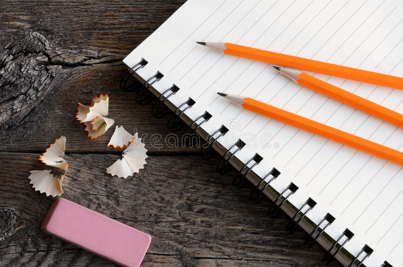 Pencil and Notebook Close Up. A top view image of several sharpened wooden pencils stock image