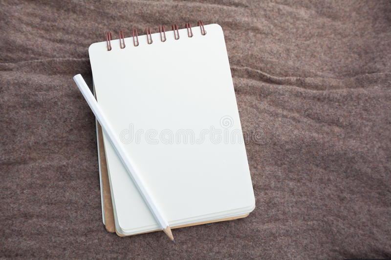 Pencil on notebook. Page in top view royalty free stock photography