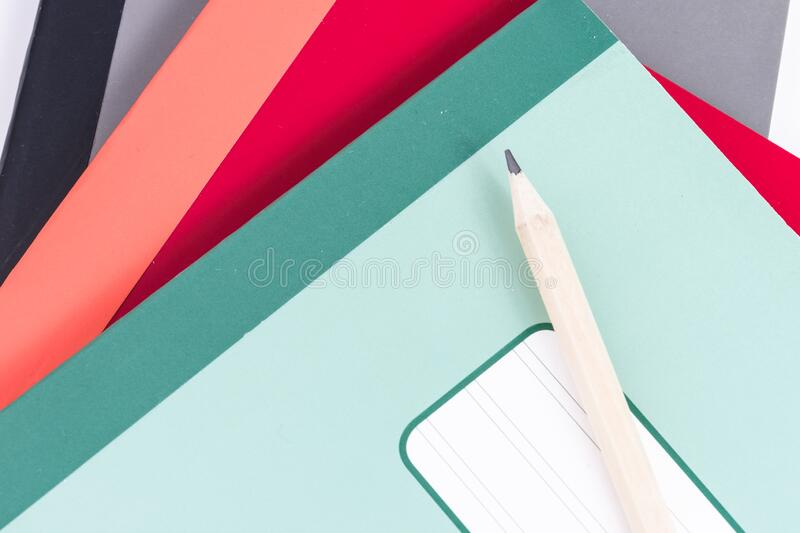 Pencil and notebook. Pencil and school  notebook of different colors stock photography