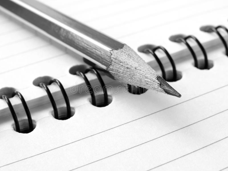 Pencil and notepad stock photos
