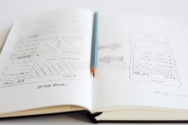 Pencil and open diary with sketch web design royalty free stock images