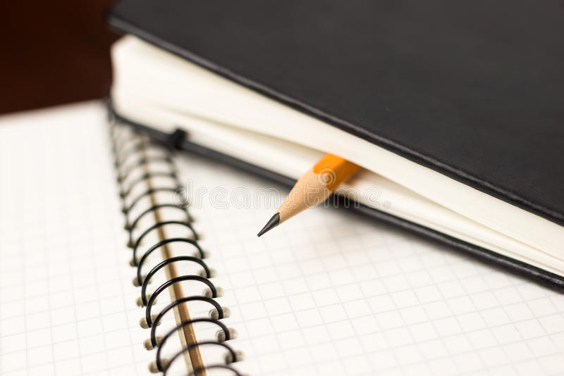 Download Pencil On The Pages Of An Closed Notebook For Records Stock Image - Image: 83714245