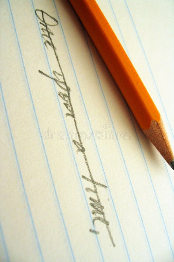 Pencil, paper, and opening line. Sharpened paper laying on lined paper beneath the words Once upon a time, which have been crossed out stock images