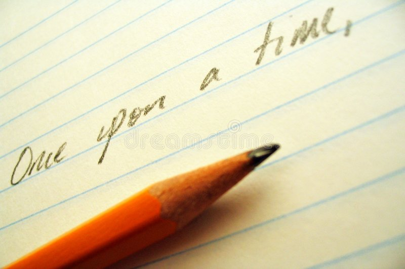 Pencil, paper, and opening line. Sharpened paper laying on lined paper beneath the words Once upon a time royalty free stock photography