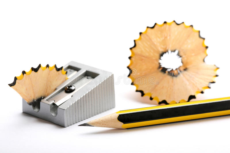 Pencil and pencil sharpener. On white background royalty free stock photos