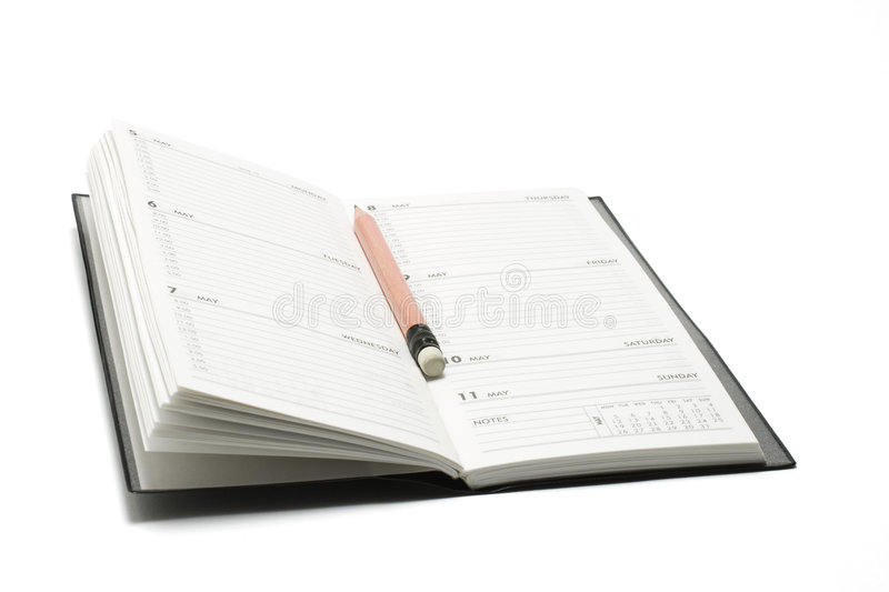 Pencil and Pocket Planner. On White Background stock photography