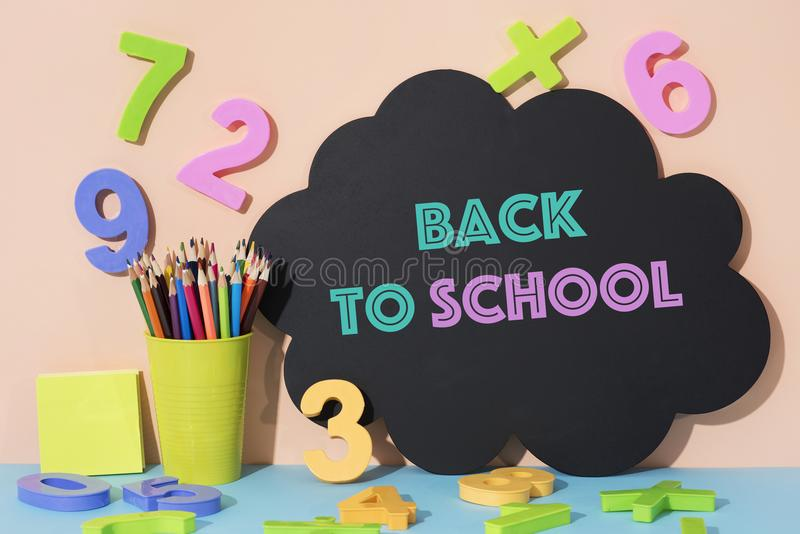 Numbers, pencil crayons and text back to school stock image