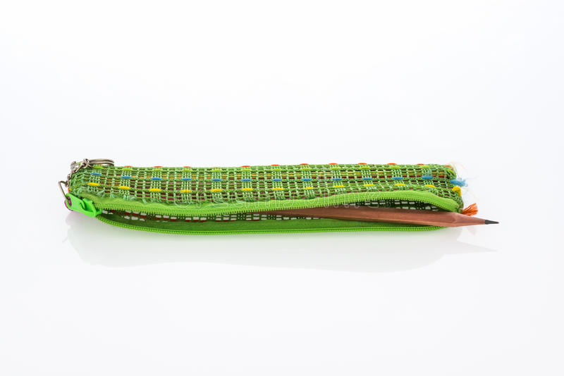 Pencil pouch. Closeup green pencil pouch on white backgrund royalty free stock images