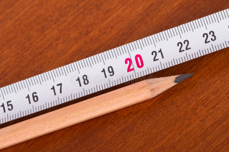 Pencil and Ruler. Top view of wood pencil and steel ruler for engineering drawing on wooden table royalty free stock photos