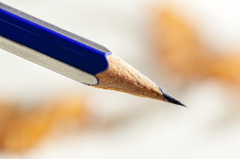 Pencil with a sharp point. Pencil with a sharp black graphite point royalty free stock image