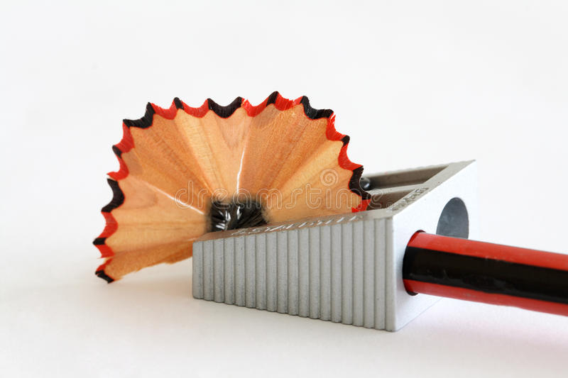 Pencil sharpener. Hand operated pencil sharpener on a white background stock images