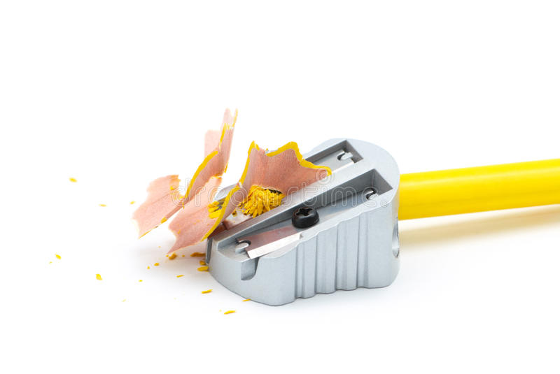 Pencil sharpener. With yellow pencil and shavings royalty free stock images