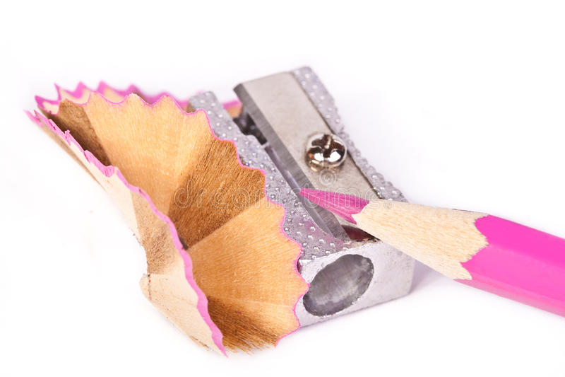 Pencil with a sharpener. Pink pencil with a sharpener across white royalty free stock photo