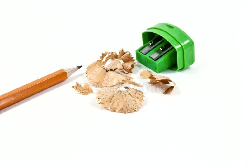 Pencil and a sharpener. Pencil, sharpener and pencil shavings royalty free stock photo