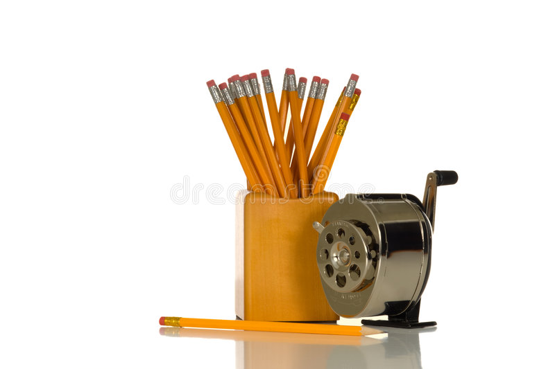 Pencil Sharpener. Manual school pencil sharpener and pencils on white background stock photo