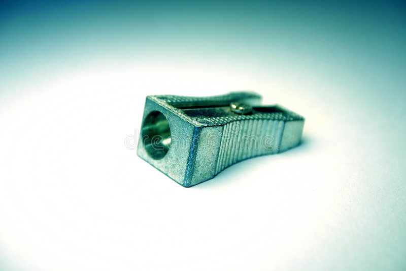 Pencil sharpener. On light background, toned by filter royalty free stock photography