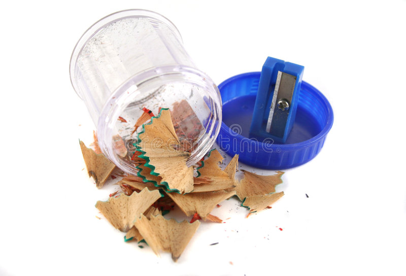 Pencil Sharpener. Plastic pencil sharpener with lead shavings tipped out royalty free stock photography