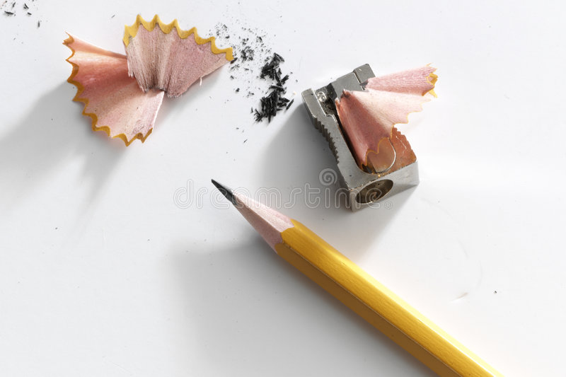 Pencil and a sharpener. Art, blu, blue, chaos, chaotic, college, design, desk, disorder, draw, education, instrument, learn, mess, notebook, pencil, red, school stock photos
