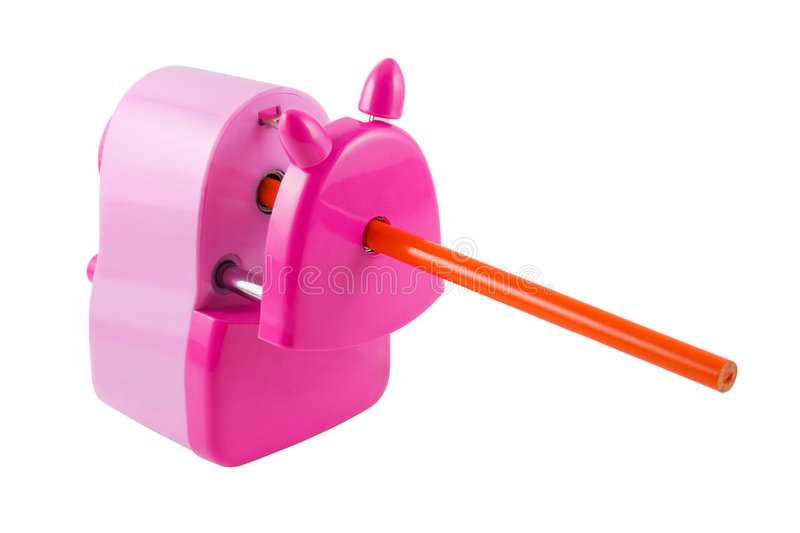 Pencil Sharpener. An orange pencil inserted in a pink pencil sharpener, isolated on white with clipping path stock photography