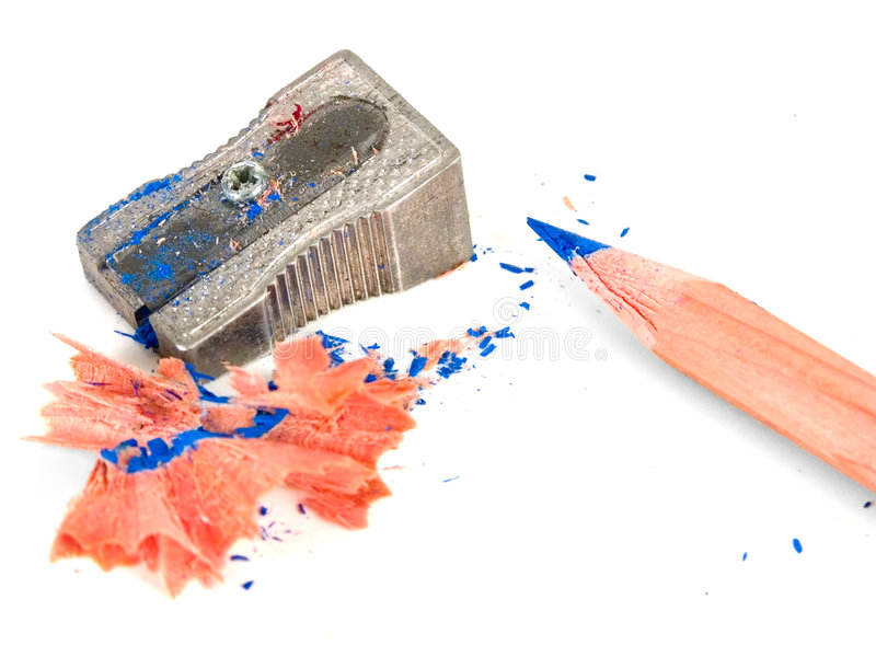 A pencil sharpener and a pencil. Against white background stock photos