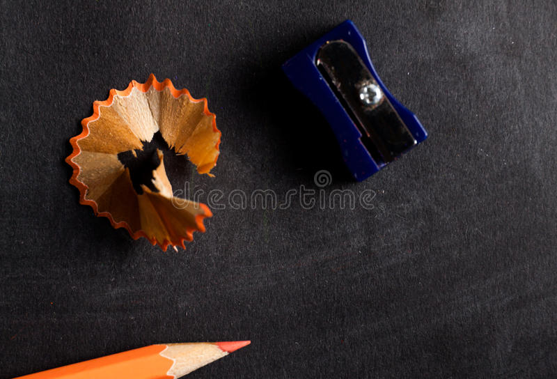 Pencil sharpener and pencil close up. On dark background stock photo