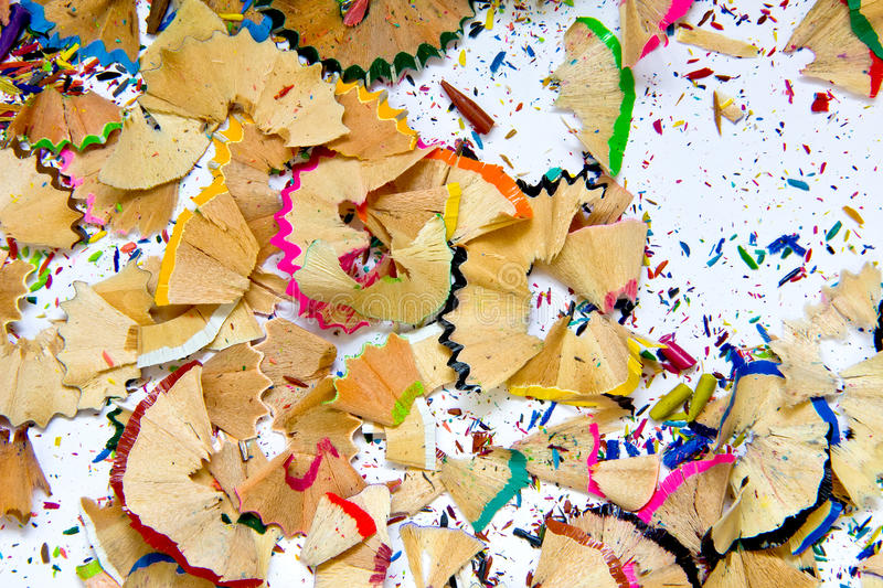 Pencil sharpener waste. On a painted background royalty free stock images