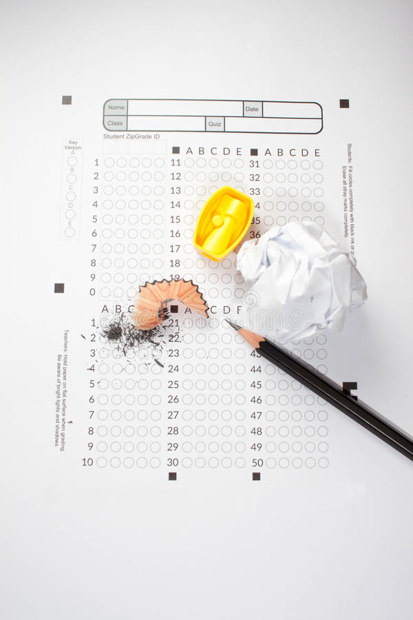 Pencil sharpeners on exam paper stock photo
