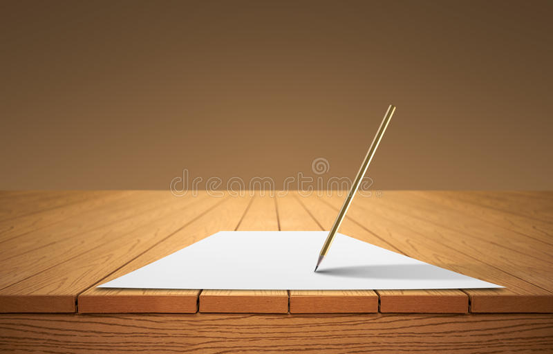 A pencil and a sheet of paper on a wooden table royalty free stock photo