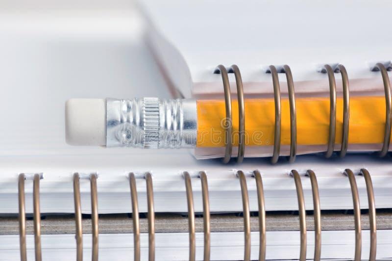 Pencil on a spiral notepad stock photos