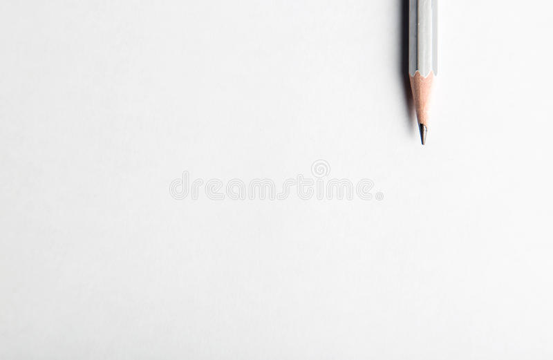Pencil tip and blank background. Silver sharpened wooden pencil tip on blank background with copyspace stock images