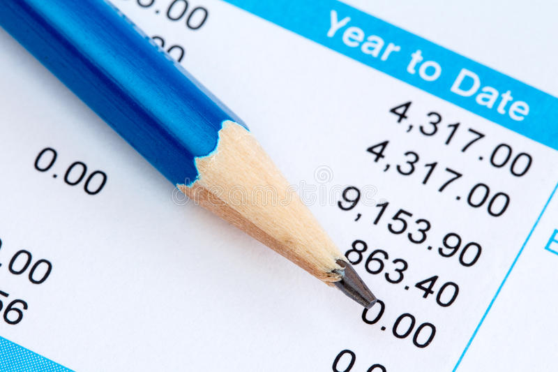 Pencil and wage slip stock photo