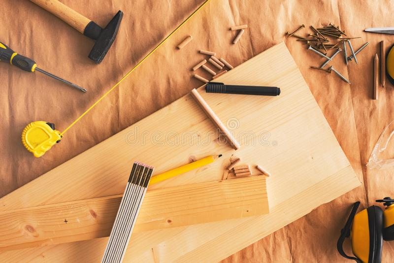 Pencil on woodwork carpentry workshop table. With other tools of trade for diy hobby project royalty free stock photo